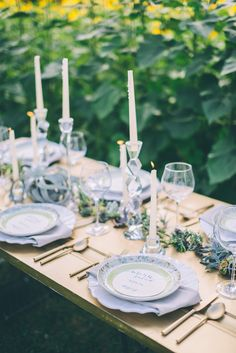 gold tablescape, photo by CJK Visuals http://ruffledblog.com/sunflower-field-wedding-inspiration #weddingideas