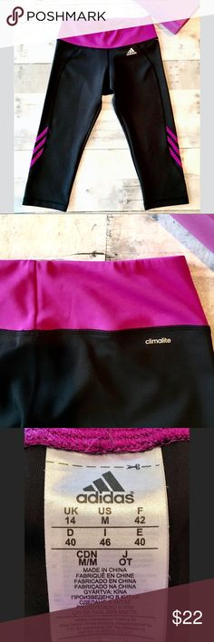 Climalite Capris black w/raspberry stripe accents LNWOT-excellent capris for sport or athliesure. No snags, or any indication of wear.  Break out into a sweat in style! adidas Pants Capris