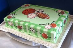 Sports Themed Birthday Cake    A simple and affordable way to dress up a sheet cake. Butter cream iced with fondant stripes and edible images.
