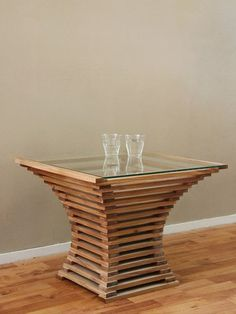 Another way to use scraps, particularl plank offcuts, is to overlap these and glue them together to make a variety of shapes. The curved table above is just one example for using offcuts to make a unique table for stunning eye-catching feature