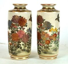 A pair of Japanese satsuma vases, Meiji Period (1868-1912) Each of cylindrical form with folded rim, the exterior sides painted with aster, chrysanthemum and foliage, below brocade transverse and gilt scalloped borders, set before an ivory ground,