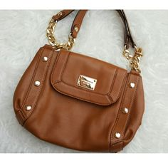 Authentic MK Handbag A simple AUTHENTIC cognac color handbag from Michael Kors.  In great condition// no rips, stains, or holes//Small scratch on the Michael Kors logo plate  I DO NOT TRADE  USE THE OFFER BUTTON IF INTERESTED Michael Kors Bags