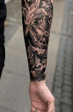 50 amazing religious tattoos you can use for your i . # body art 50 e . - 50 amazing religious tattoos you can use for your … # Body Art 50 amazing religious tattoos tha - Forarm Tattoos, Forearm Sleeve Tattoos, Best Sleeve Tattoos, Tattoo Sleeve Designs, Top Tattoos, Tattos, Statue Tattoo, Angel Sleeve Tattoo, Angel Tattoo Men