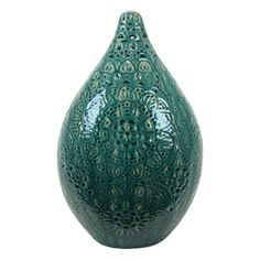 Ceramic vase with a turquoise finish and medallion floral detail.   Product: VaseConstruction Material: Ceramic