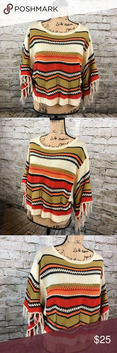 ROOM MATES • Tribal BOHO Sweater ROOM MATES • Tribal BOHO Sweater  Cute fringes on the Sleeves of this oversized sweater make this truly unique.  Soft and stretchy  Pit to pit is 19 inches Shoulder length down to the bottom is 19.5 inches  Preloved in excellent condition   N57 Room Mates Sweaters