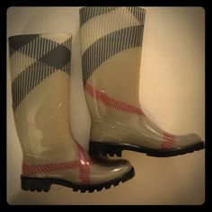 """Burberry Check Pattern Rain Boot Never worn!!    Burberry Brainec with House Check. Size 37 Euro  Oversized check pattern covers a waterproof rubber rain boot with a durable lug sole.  Removable insole. Approx. heel height: 1"""". Approx. boot shaft height: 12 1/2""""; 14 1/2"""" calf circumference. Rubber upper/textile lining/rubber sole. Made in Italy. Salon Shoes. Approx. boot shaft height: 12 1/2""""; 14 1/2"""" calf circumference. Burberry Shoes Winter & Rain Boots"""