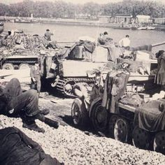 """Soldiers and tanks from the 101st s.SS-PzAbt (Tiger) and 1st SS-PzRgt """"LSSAH"""" (Panther) have a rest after hard combats in Normandy, autumn 1944"""