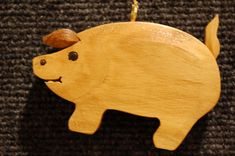 This little pig is cute and charming, sure to be a treasured addition to your holiday tree. Port Orford Cedar, Holiday Tree, Holiday Decor, Western Red Cedar, Little Pigs, Nativity, Carving, Christmas Ornaments, Incense