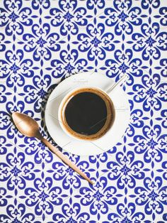 #Cup of black Turkish or Eastern style coffee Cup of black Turkish or Eastern style coffee over oriental Moroccan patterned background top view