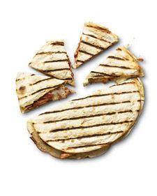 Adobo-Marinated Chicken Quesadillas.  Chicken breasts gain a smoky richness and a little heat from marinating in adobo, a tangy Mexican chile sauce, available at most stores. Find recipe at WholeLiving.com - pinned by Amy Marie Shadle
