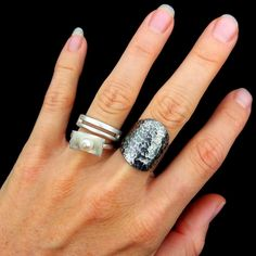 Have a look at what I did with 2 silver rings a friend of mine gave me because she didn't wear them at all. that's upcycling .