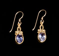 Ribbon Loop Earrings with Tanzanite from Sierra by Sonoma Art Works. American Made. See the designer's work at the 2015 American Made Show, Washington DC. January 16-19, 2015. americanmadeshow.com #earrings, #jewelry, #tanzanite, #14kgold, #vermeil, #americanmade