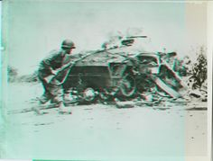 https://flic.kr/p/frCU4c | 77.09.4405a | Radiotelephoto.New York Bureau.Lesson In Caution.France -- With cautious step, Sgt. Andrew Harding, Bridgeport Conn., approaches a burning Nazi armored car. The vehicle had been knocked out on the road to La Mont by an American three-inch shell..Credit: Signal Corps Radiotelephoto from ACME.Date: 8-14-44