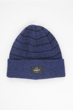 78075987032 OBEY Vernon Beanie in Cobalt Black. Fine gauge knit beanie with rolled  cuff. Obey branded patch on front cuff.