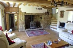 What a masterpiece? Granite inglenook fireplace with woodburner spiral stair exposed beams - all what you'd expect in a old longhouse - but actually century craftsmanship & comforts. Granite Fireplace, Inglenook Fireplace, Bedroom Fireplace, Fireplace Design, Open Fireplace, Cottage Stairs, Cottage Living Rooms, House Stairs, Cottage Interiors