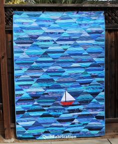 jellyroll quilts Seafarer, a string quilt, is today's feature Jellyroll Quilts, Patchwork Quilting, Scrappy Quilts, Star Quilts, Easy Quilts, Quilting Fabric, Ocean Quilt, Beach Quilt, Rainbow Quilt