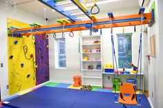 Fun Factory Sensory Gym offers custom designed in-home sensory gyms to fit into small spaces while leaving ample space to move about when not being used. A sensory gym will both challenge and stimulate a child in a safe indoor environment. Kids Indoor Gym, Indoor Jungle Gym, Indoor Playroom, Kids Gym, Kids Indoor Playground, Kid Playroom, Kid Spaces, Small Spaces, Kids Basement