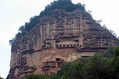 "Maijishan (""Wheatstack Mountain""), located on the northern side of the Qinling Mountain Range and at a height of 1742m above sea level, gets it's name from its giant, haystack-like shape. The mountain's fame arises not just from its appearance, but from the many Buddhist caves that are gouged into its southwestern face. This is the fourth largest area of concentrated Buddhist grottoes in China, after Dunhuang, Datong and Luoyang."