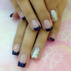 Midnight blue and silver French tips. Paint your French tips in striking midnight blue polish while adding silver glitter polish on your other nails for effect.