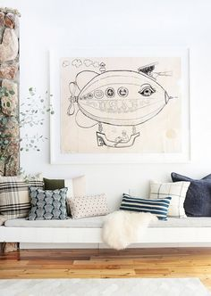 Living space with a floating bench and eclectic art