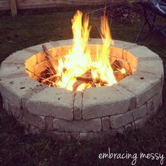 Simple DIY fire pit,   36 trapezoid and 35 rectangle paver blocks only, a level and a shovel!