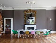 Ilse Crawford Dinder House Somerset England, dining room, color Eames chairs, chandelier, large ornate mirror, herringbone floors