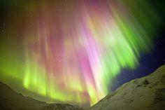 "Auroras with this crown shape are referred to as ""coronas."" (Dhanachote Vongprasert / Shutterstock)"