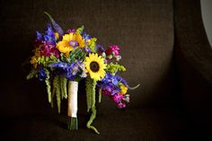 Overgrown Bridal Bouquet - Warmth and Happiness: 20 Perfect Sunflower Wedding Bouquet Ideas - EverAfterGuide