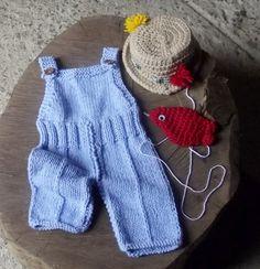 conjunto de macacão , chapéu e peixinho confeccionados em tricô ( macacão) chapéu e peixinho ( crochê)  cor - azul , bege e vermelho  tamanhos Rn / 1 a 3 / 3 a 6 /6 a 9 meses R$ 99,00