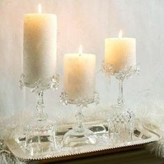 Fancy stemware becomes pretty candle holders