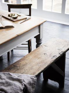 Lewis dressed up the family's English farmhouse table by painting the base and legs pale gray using Eicó, a low-VOC line of paints. The benches came from John Cornall Antiques.