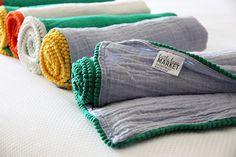 Muslin baby blanket with pom pom edging