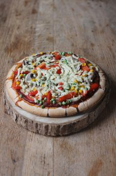 Vegan + Gluten Free Vegetable Pizza!!! Topped with mixed vegetables, and vegan melty cheese.