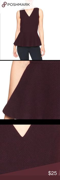 🎉 NWT BR Burgundy Sleevesless Peplum Top, Sz XS PRODUCT DETAILS:  V-neck sleeveless top with peplum hem. Zipper closure at back with hook-and-eye closure. Made exclusively for Banana Republic Factory.  FABRIC: 64% polyester, 34% rayon, 2% spandex. Banana Republic Tops