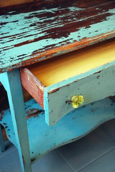 Antique chippy table in Miss Mustard Seed's milk paint. Inside in Annie Sloan's Arles, and yellow crystal knobs. From Malenka Originals.