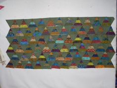 1000 pyramid quilt | Sew your rows together. Next line up your ruler on inside points of ...