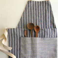 Adjustable Kitchen Apron - There's no need for multiple aprons when you can make one that serves every chef in your house. Sew an Adjustable Kitchen Apron that you and your husband can share. This tutorial will show you how to make an apron with a front pocket that can hold your utensils as you walk around your kitchen.