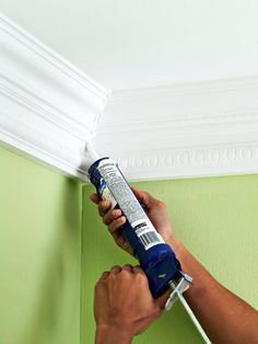 Basic Molding Installation: I love crown moulding because it gives a room a finished look. I love white caulk!  It is a best friend to a DIYer because it makes so many things look finished (and forgives flaws)!