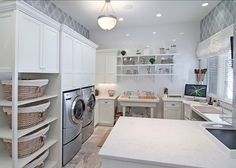 Spacious Laundry room with great storage ideas. #laundryRoom #laundryRoomDesign #LaundryRoomIdeas