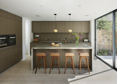 Kitchen Architecture - b3 furniture in clay with a stainless steel work surface.