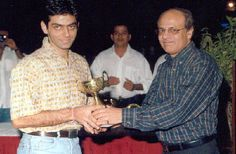 Deepak pandit, assistant commissioner customs department at an award function http://ispsquash.com/photogallery/pg_36.htm