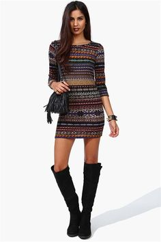 Awesome Sweater Dress and I love her boots! - I would wear with leggings.