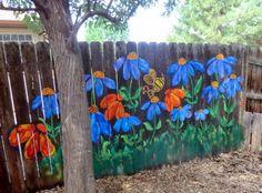 Acrylics on cedar fence.  Happy!