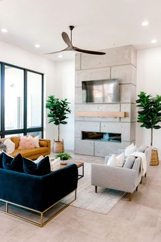 """""""I love the combo of kind of mid century meets modern clean lines."""" Influencer: Kailee Wright Designer: Ashley Cooper Photographer: Aubrey Taiese - May 26 2019 at Home Interior, Home Living Room, Interior Design Living Room, Living Room Furniture, Living Room Designs, Blue Couch Living Room, Midcentury Modern Living Room, Modern Contemporary Living Room, Interior Livingroom"""
