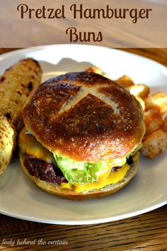 Pretzel Hamburger Buns - These pretzel hamburger buns were so easy to make. BE BRAVE! Don't let making bread scare you. It really is quite easy and well worth it. These pretzel hamburger buns are so tender and add another layer of flavor to you burger. Pretzel Bun Recipe, Pretzel Bread, Homemade Buns, Homemade Pretzels, Homemade Breads, Bread Machine Recipes, Bread Recipes, Hamburger Buns