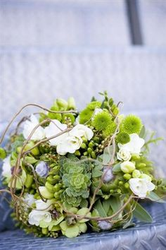 I love this bouquet. If it had a tad more flowers and a little less green but only a little little less, it would be my dream bouquet.