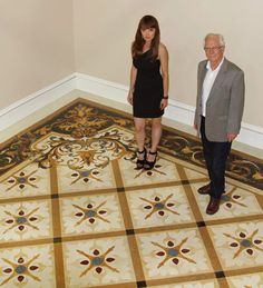 With whole floor designs marble medallions, borders, and accents integrate the floors of the formal areas of the home.