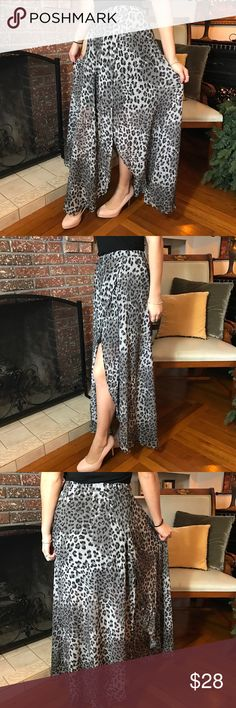 """Nine Bird maxi skirts. B053 Nine Bird maxi skirts with animal print. High waist maxi skirt with elastic waistband. There is a slip type skirt that comes up to the waist on both sides. 100% polyester. Lining it's a black midi skirt. Lightweight material. Small it's W26"""" (stretches 32"""") Long 37""""✨✨Medium W 28"""" (stretches to 34"""") 37"""" long. ✨✨ Large it's W30"""" (stretches to 36"""") 38"""" long. Nine Bird Skirts Maxi"""