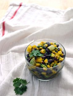 This cold black bean and corn salad is perfect for a picnic or hot summer's day. Serve as a side, on top of greens as a main course salad, or use as a salsa with tortilla chips!