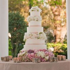 added to favorites  photo by: Brandy J Photography  event design: Get Polished Events  location: The Elms Mansion  cake: Melissa's Fine Pastries  find wedding cake bakers in your area ▸  see more: cake, blush, ivory, light pink, pastels, pink, spring, romantic, buttercream, cake stand, wedding cake flowers